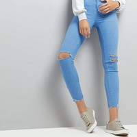 Light Blue Ripped Skinny Raw Hem Jeans | New Look