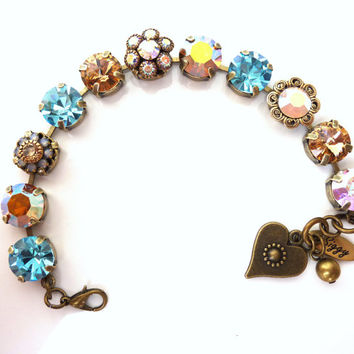 NEW in the siggy collection, Swarovski crystal tennis bracelet, topaz and aqua on antique brass, chunky 11mm, better than sabika