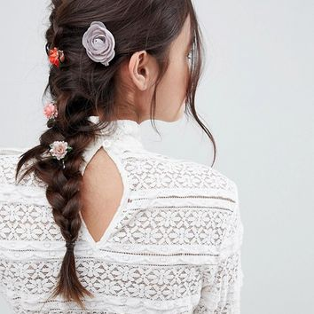 ASOS Pack of 4 Mixed Floral Hair Clips at asos.com