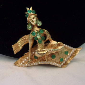 HATTIE CARNEGIE Vintage Woman on a Flying Carpet Genie Brooch Rhinestone Jade Glass Book Piece Rare Figural Pin