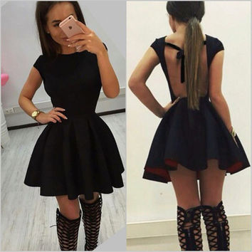 Fashion Solid Color Wave Irregular Hem Backless Hollow Strap Pack Hip Short Sleeve Mini Dress