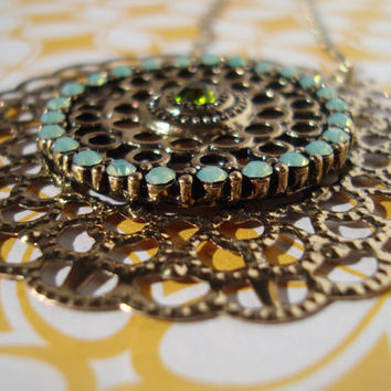 Gold and light blue pendant necklace