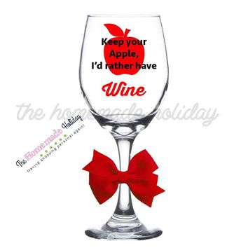 Keep your apple, I'd rather have wine, wine glass