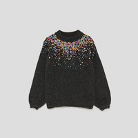 SWEATER WITH COLOURED SEQUINS DETAILS
