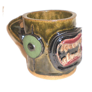 Eye Coffee Cup (8) - Stoneware clay slab pot with pattern of molded eyes and fangs