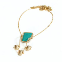 Women gold necklace with framed turquoise leather and three gold links