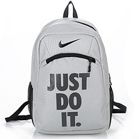 NIKE JUST DO IT Tide brand men and women sports outdoor travel backpack Grey