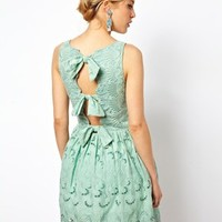 ASOS Premium Skater Dress In Broderie With Bow Back at asos.com