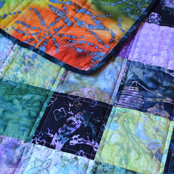 Quilted batik lap quilt, small throw, baby blanket, crib quilt or play mat.  Bali batik patchwork quilt in purple, lilac and green.