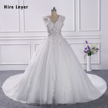 HIRE LNYER 100% Real Picture 1.5 Meter Chapel Train Pearls Lace Appliques Flowers Princess Wedding Dresses 2018 With Petticoat
