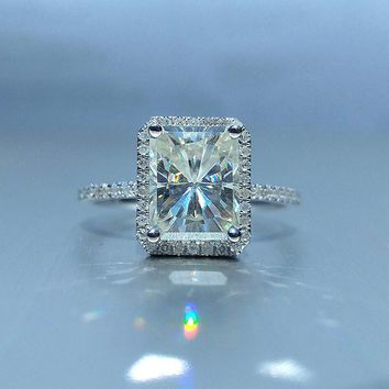 9x7mm, 2.7ct Radiant Cut Moissanite set in a 14K White Gold Diamond Halo