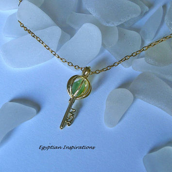 Sea glass locket. Green sea beach glass necklace.