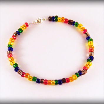 Rainbow Seed Bead bracelet .. Gay Pride bracelet with rainbow glass seed beads and a magnetic clasp.