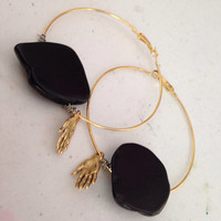 Manos the hands of date palmistry hoops in black and gold