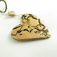 Bronze and sterling silver broken but mending heart necklace pendant