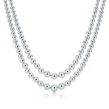 Tiffany & Co. - Graduated bead double row necklace. Sterling silver.