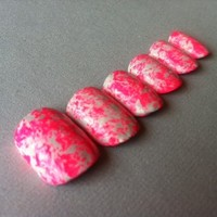 Pink and white speckled fake nails from Paint and Polish
