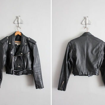 1980s vintage distressed motorcycle jacket by allencompanyinc