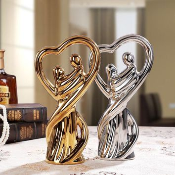 Silver couple hug ceramic ornaments modern home decor crafts room decoration characters porcelain figurine statue wedding decora