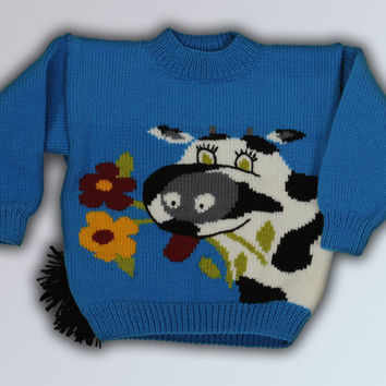 Winter warm knitted blue sweater for children with cow.  Ready for shipment.