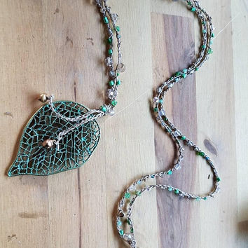 Long sparkly gypsy boho beaded chain crochet necklace with verdigris patina brass leaf pendant