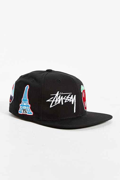 f0e4299c07d Stussy World Tour Icons Snapback Hat from Urban Outfitters