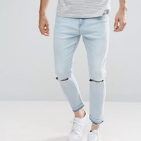 Stradivarius Slim Jeans With Knee Rips In Light Wash at asos.com