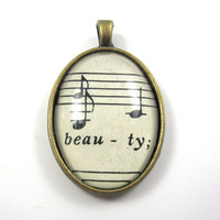 Music Note Pendant with Beauty from Vintage Music Sheet, in Glass Tile Oval