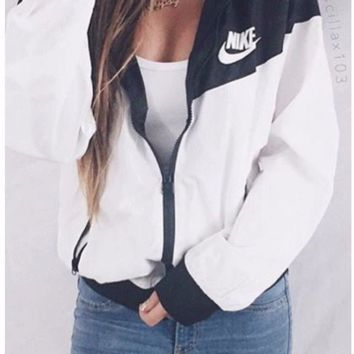 Nike Women Windrunner Windbreaker Black & White Sport Hooded Sweater Jacket NWT - Best Deal Online