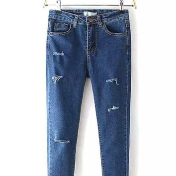 Blue Ripped Skinny Jeans - Mid Rise