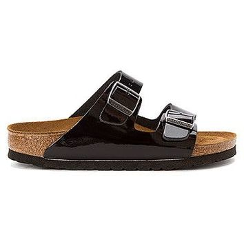 Women's Arizona Sandal in Patent Black with Soft Footbed by Birkenstock