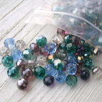 Bag of mixed Crystal Beads, mostly Swarovski Rondelles, but also other brands and some are more round, some AB, some not, bags of 50 beads