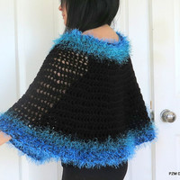 Black crochet circle poncho with blue and green fur trim, outerwear
