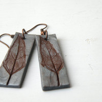 botanical earrings in silver clay with a lemon balm leaf impression painted in brown ~ pattern
