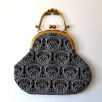 Black and white art nouveau bag. monochrome. flowers. trees. hearts. handmade. bronze tone. embossed. red satin. lined. clasp handle bag