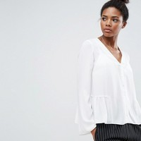 ASOS V Neck Blouse with Ruffle Hem at asos.com