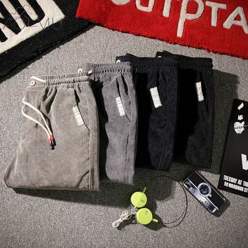 AOMU 2017 Autumn Men's Corduroy Casual Pants Fitness Clothing Tracksuits Trousers Slim straight Workout Sweatpants Pocket Male