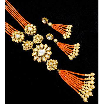 Multiple Kundan charm pendant with orange crystal bead long chain tassel necklace and dangling long earring set