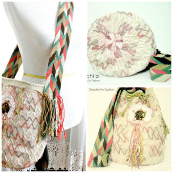 Wayuu Mochila bag adorned with lace, stones and insets.