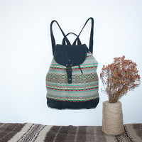 Ladies handmade backpack with black suede leather and unique handwoven textile