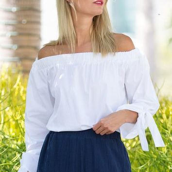 Retro-inspired off-the-shoulder blouse