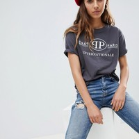 ASOS DESIGN relaxed t-shirt with paris international slogan at asos.com