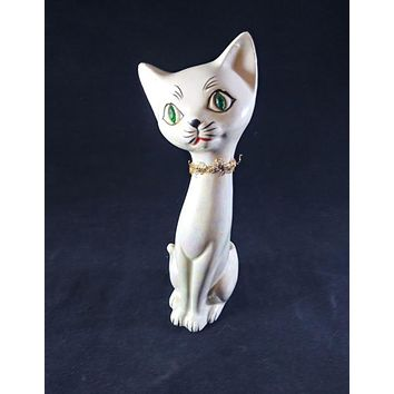 White Lustreware Looking Cat With Pot In Back