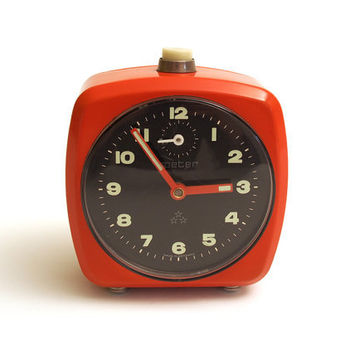 Retro red / orange wind up alarm clock. Peter brand. Made in Germany.