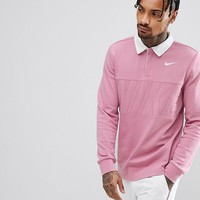 NNike SB Long Sleeve Polo Shirt In Pink 885847-678 at asos.com