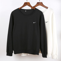 Nike: Contracted and relaxed round collar cotton sets of men and women lovers who clothes