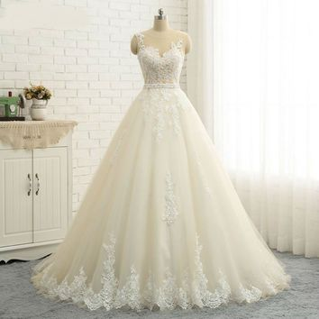 Sexy Illusion Back Embroidery Appliques Quality A line Wedding Dresses Sleeveless Pearl Sash Wedding Dress