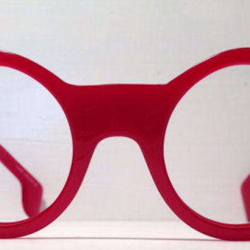 Vintage eyewear. A really Fabulous frame! Round, Cherry Red, Wide Temples, Made in England. Artist. Avant Garde. Fashion Statement.
