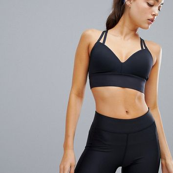 Under Armour Pinnacle Mid Support Bra In Black at asos.com