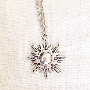 Silver ornate sun pendant necklace